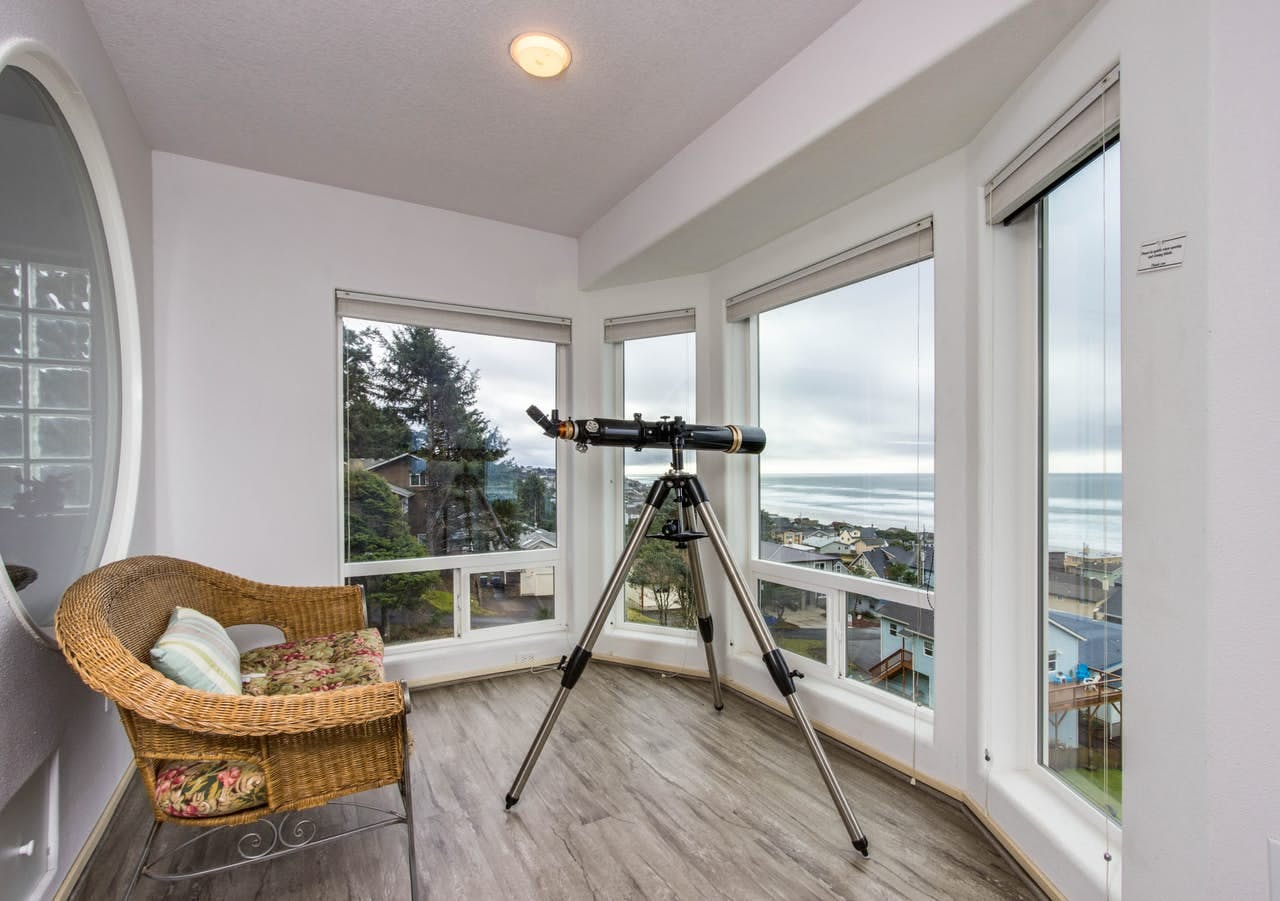 a telescope overlooking the ocean from an oregon coast vacation rental