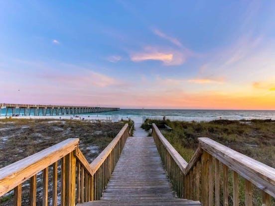 Boardwalk leading toward the beach in Panama City Beach, FL