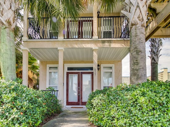 Vacation rental home in Panama City Beach, FL with upstairs balcony