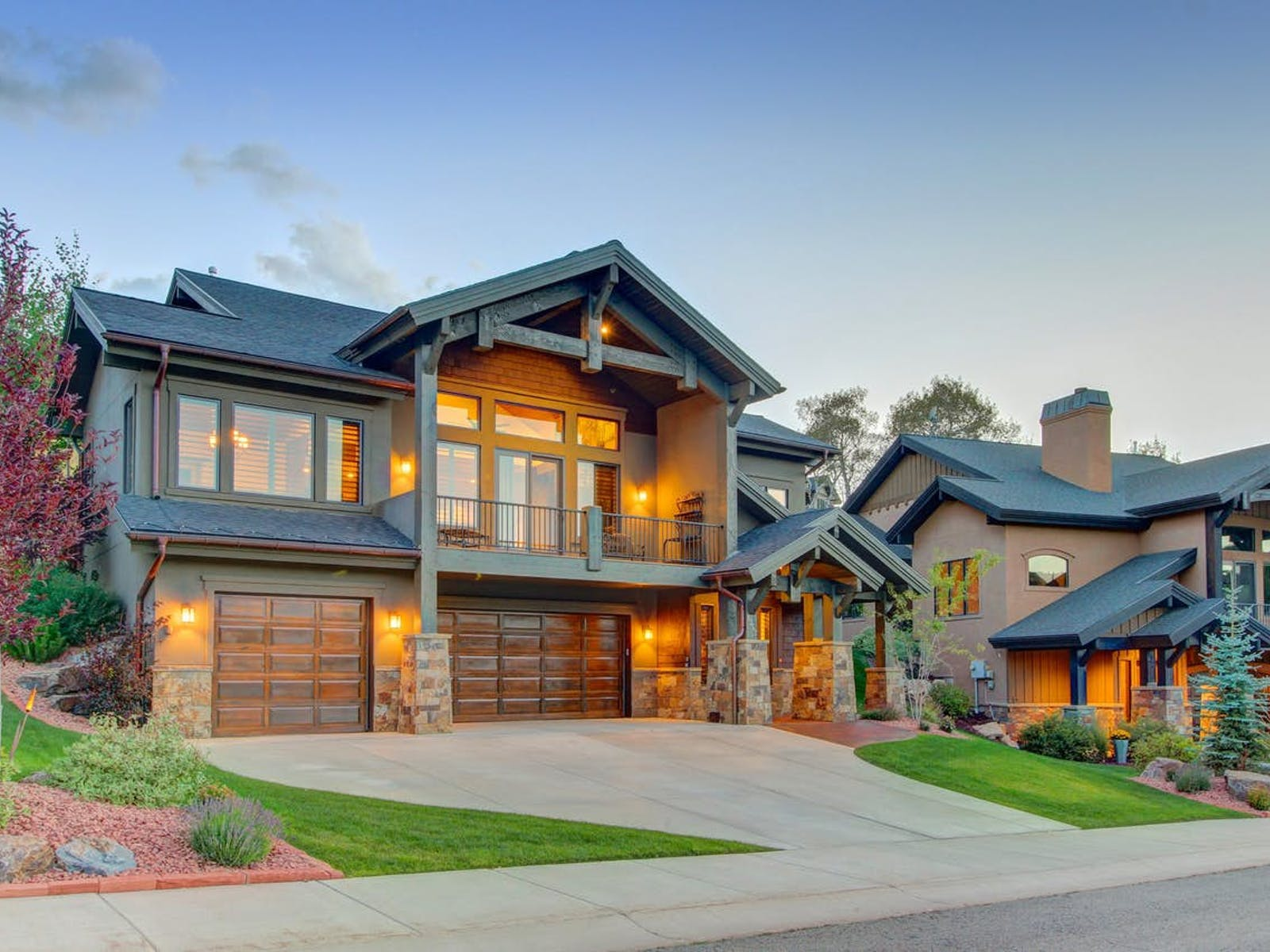 vacation home in park city with three car garage and landscaped lawn