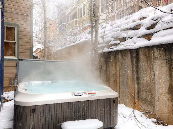 Park City vacation rental hot tub on a snowy day