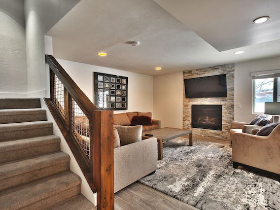 Enjoy this open layout vacation home while sitting in front of the gas fireplace