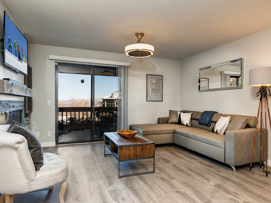 Park City vacation condo features natural wood and stone decor, Smart TV, and private balcony