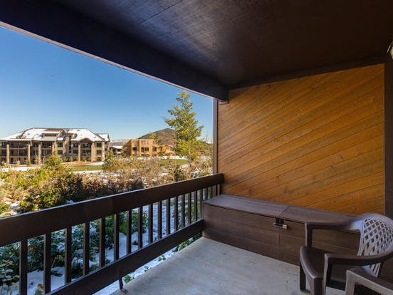 Private balcony features views of surrounding mountains, Snydervlle Basin, and 13th fairway of Canyons Golf Course
