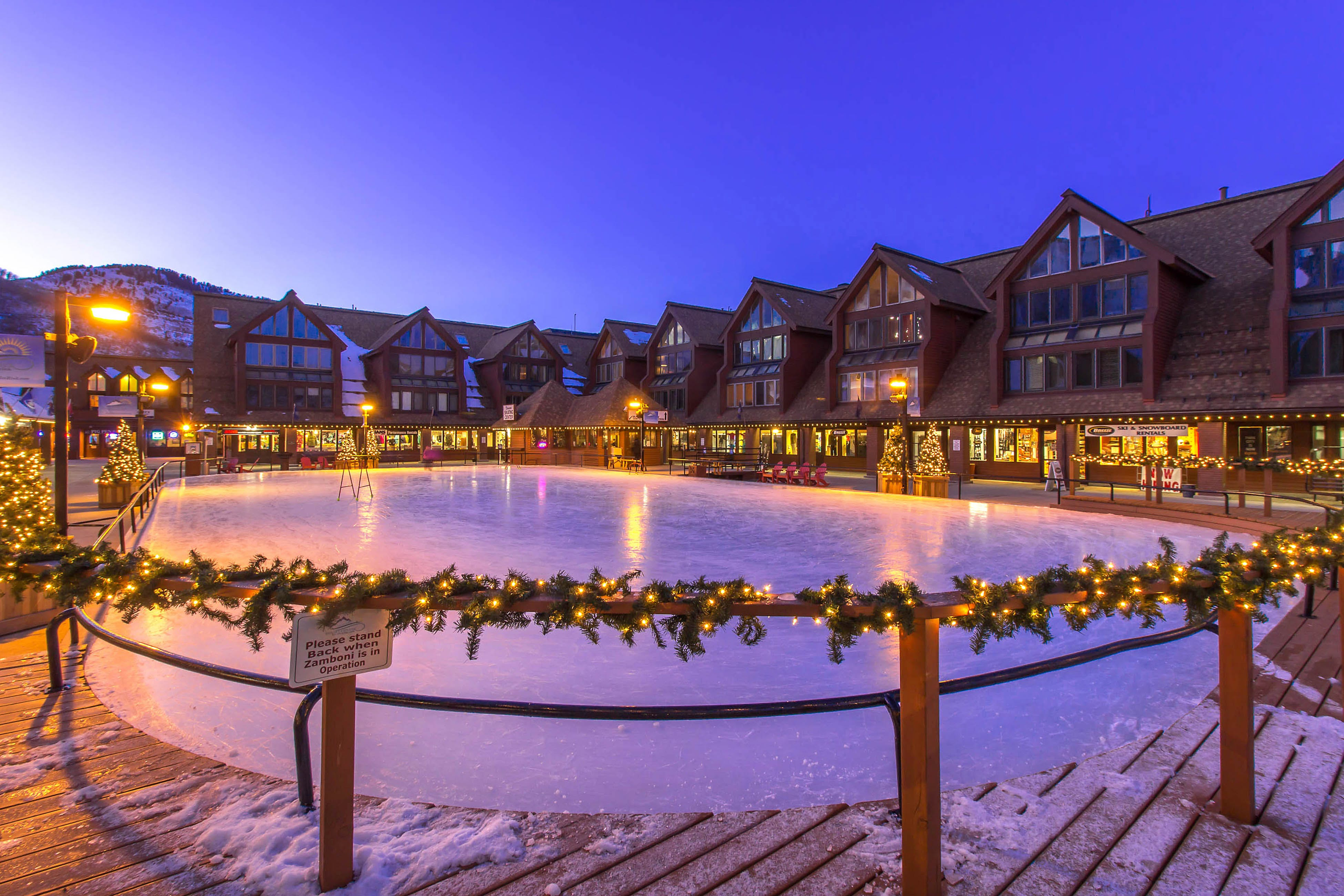 Night time view of the lit up ice skating rink in Park City, Utah
