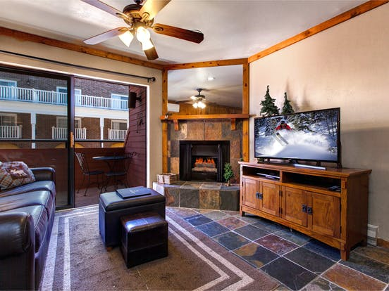 Ski in/ski out condo located in Park City, Utah featuring private balcony, fireplace and cozy seating