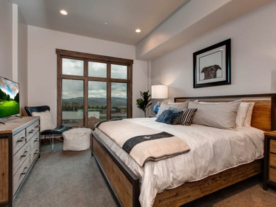 Stylish bedroom featuring a king bed, tv and plenty of storage