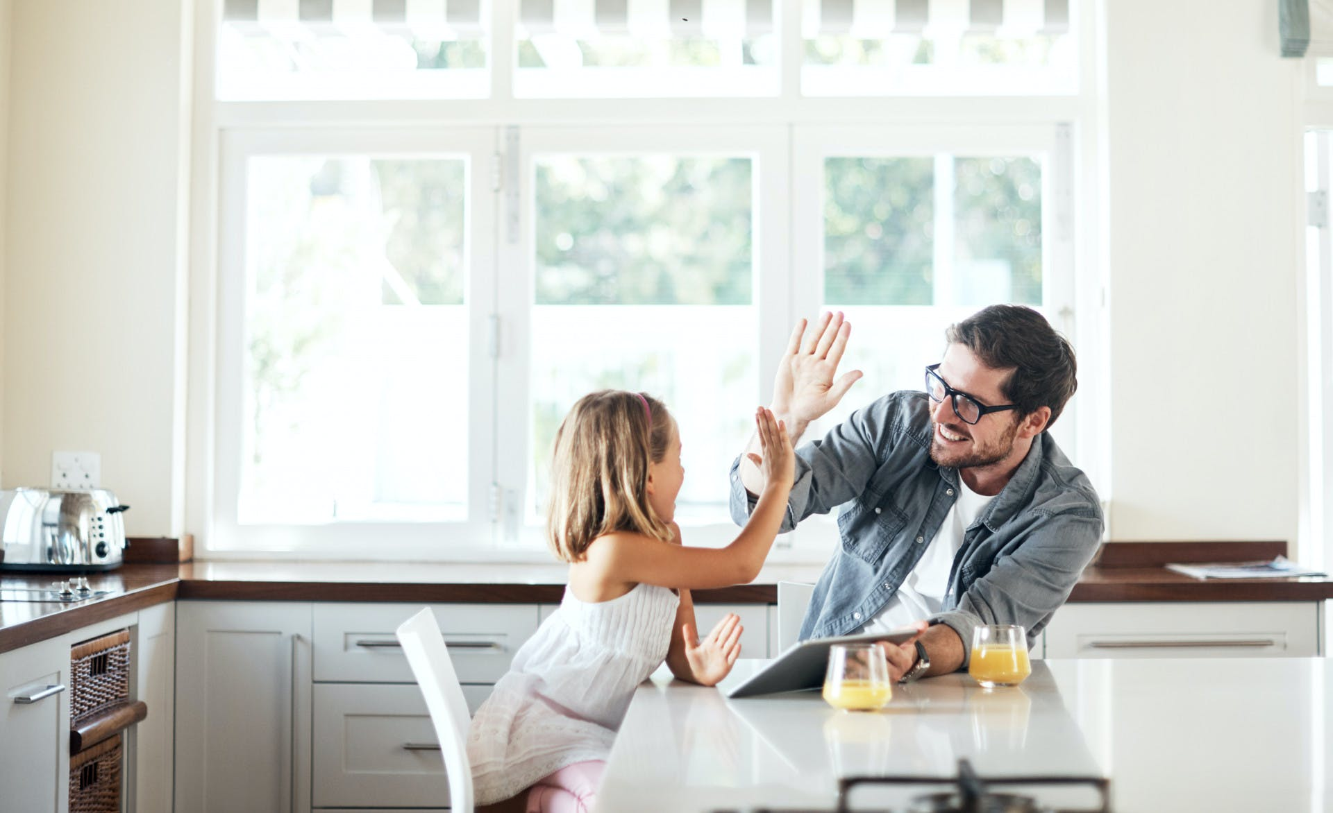 Father and daughter high-fiving