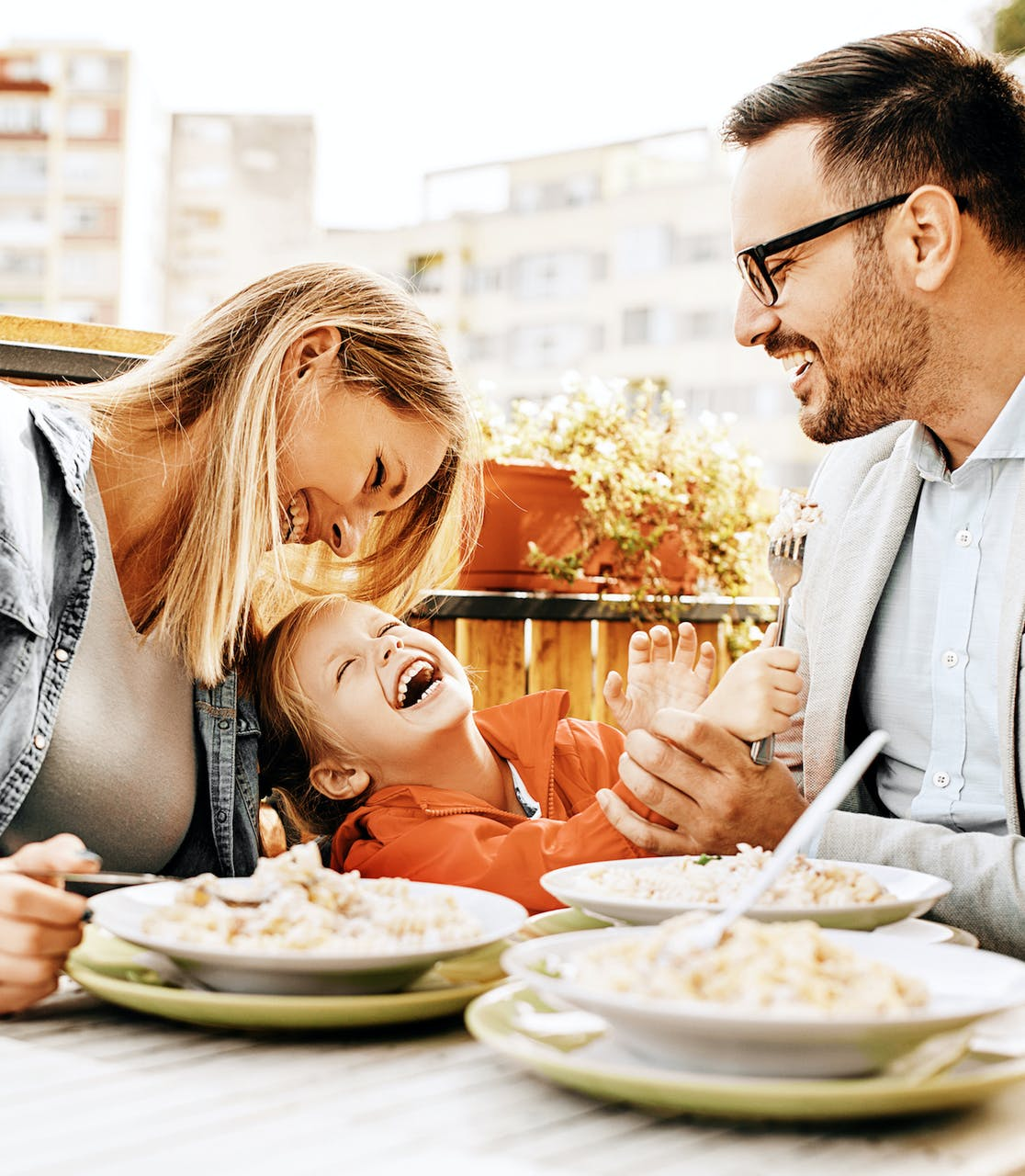 Family laughing and enjoying a meal