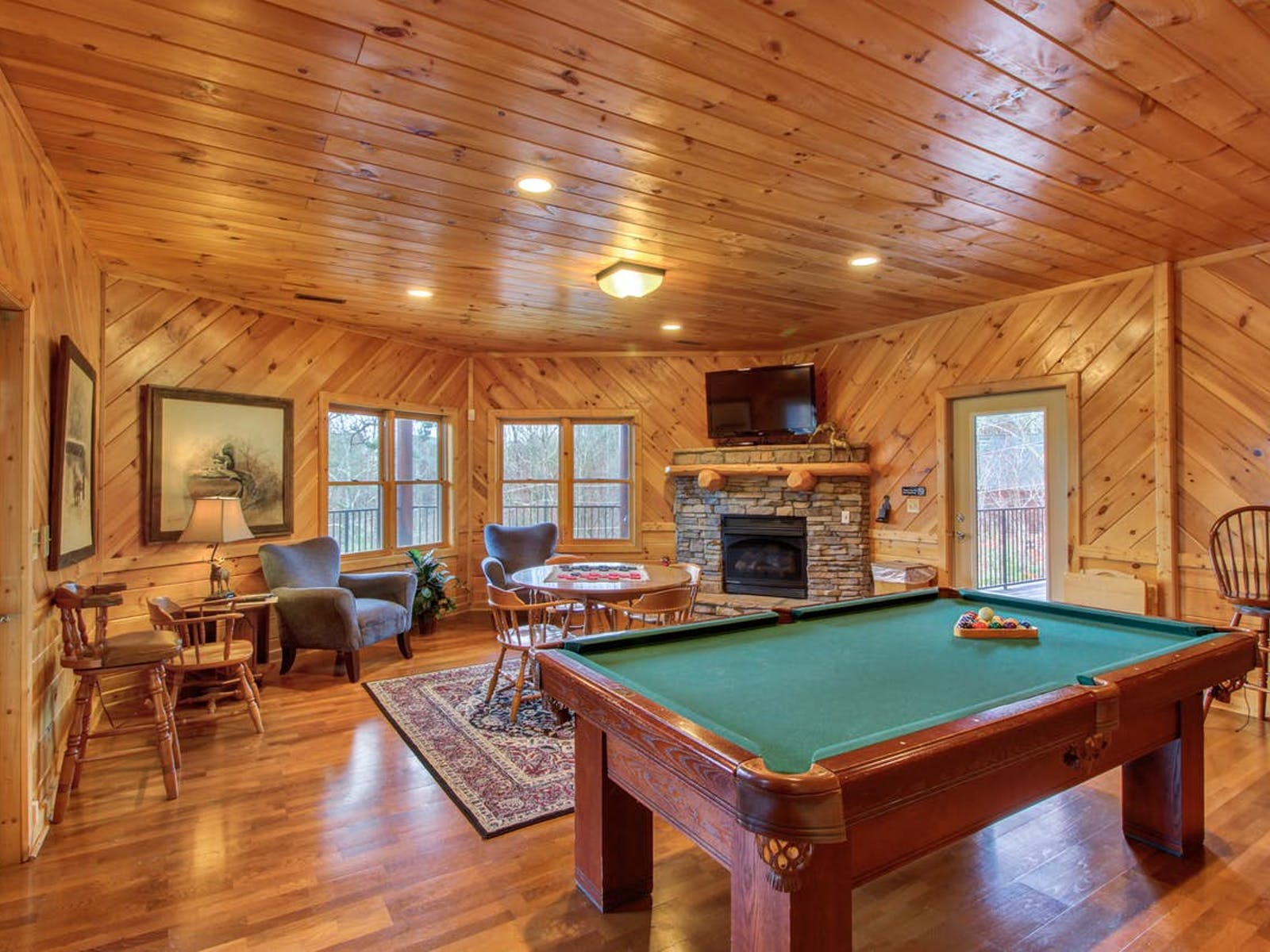 Sevierville vacation cabin with game room with a pool table, a fireplace, and TV