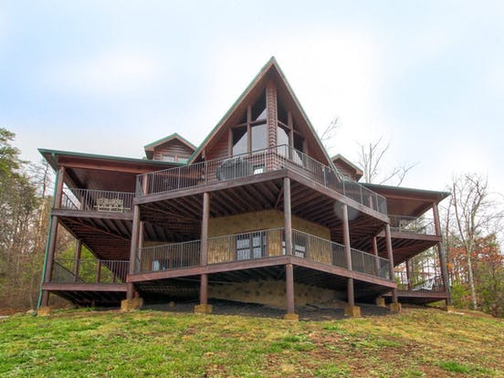 Massive floor-to-ceiling windows and a wraparound deck at this gorgeous Sevierville cabin