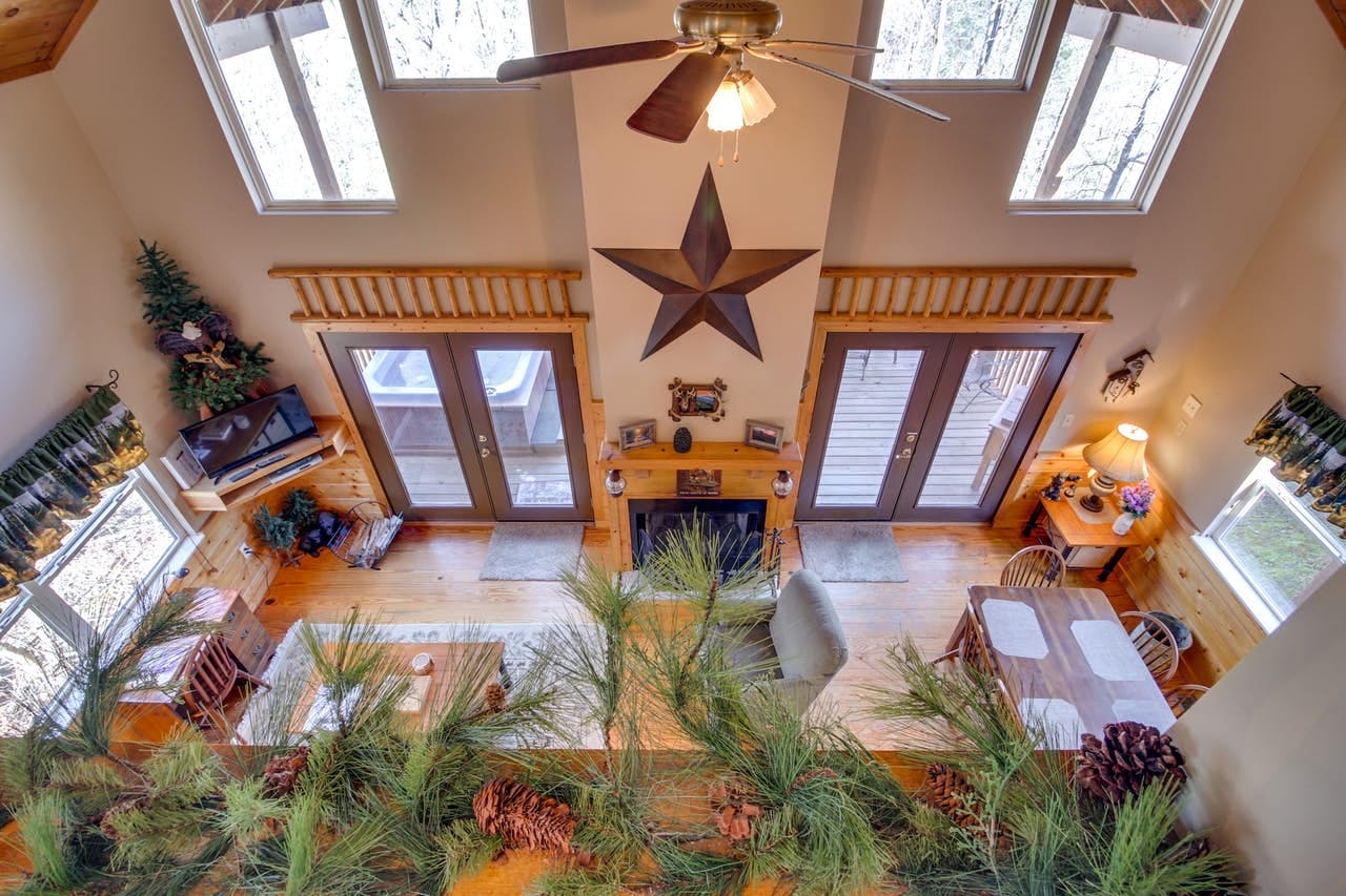 Bird's-eye view of vacation cabin living space with view of private hot tub