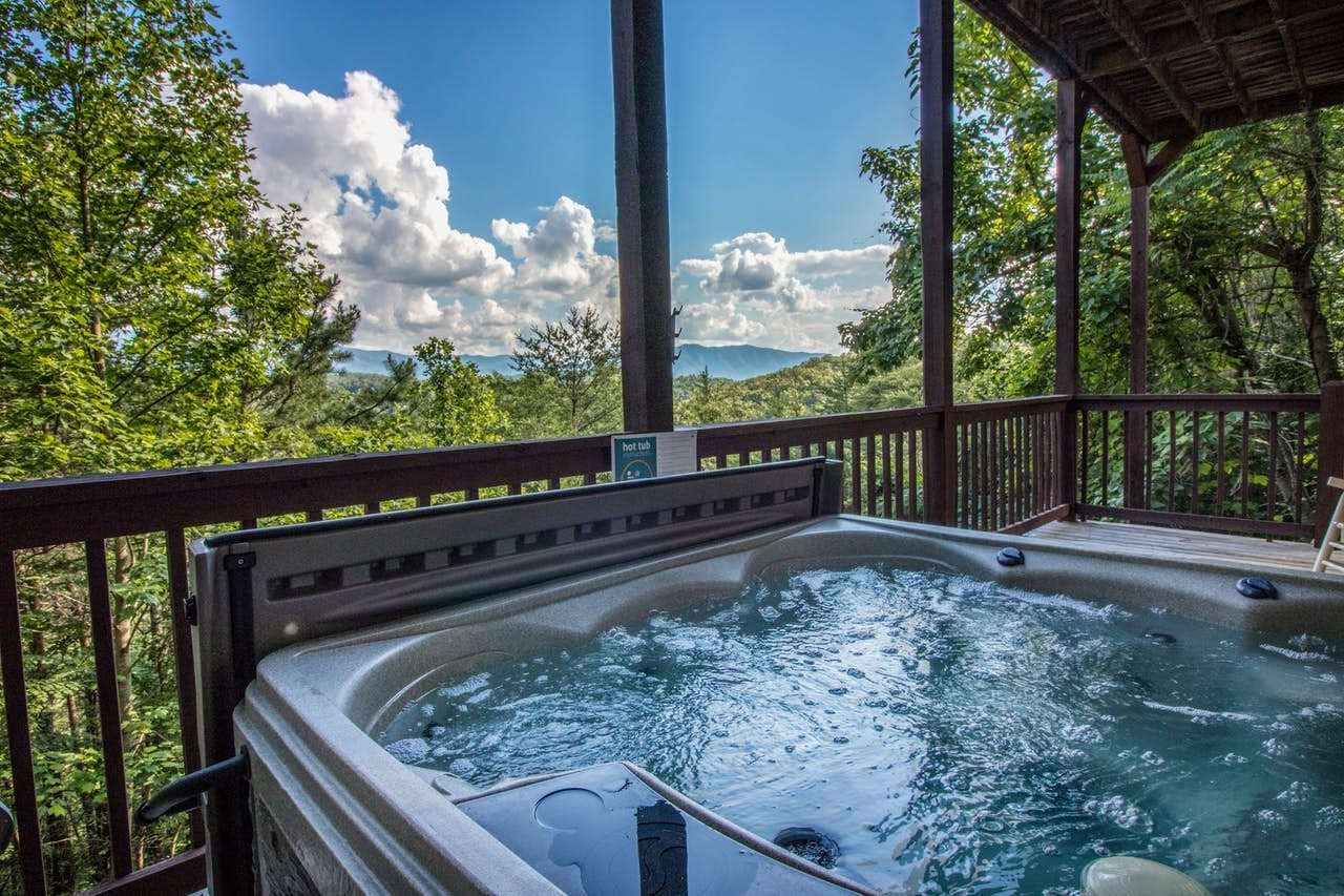 Gorgeous natural views from a private hot tub at this Townsend, TN vacation cabin