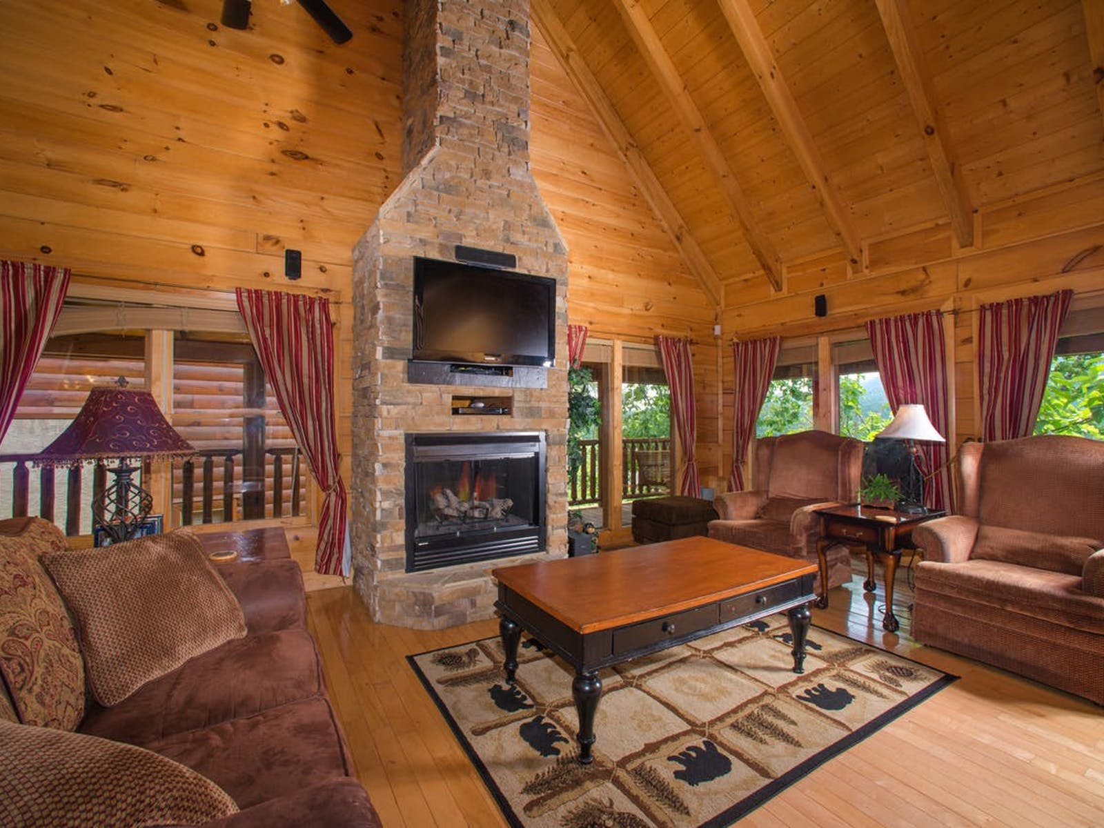 Cozy living room of Sevierville, TN cabin featuring large flat screen tv and fireplace