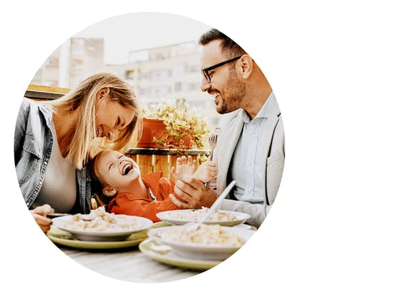 family enjoys breakfast together