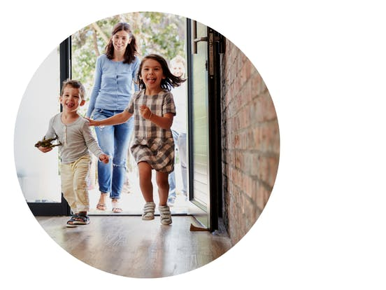 mother with kids walking in front door of vacation rental