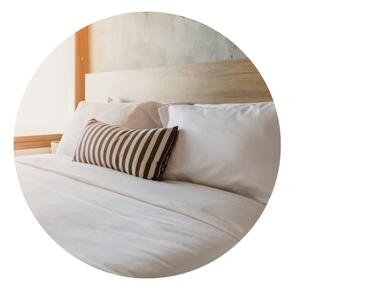 Clean bed linens with simple pillow