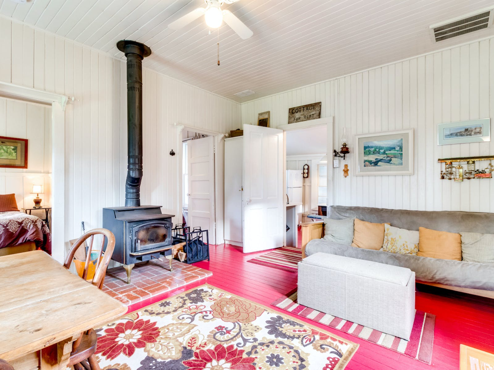 bright living room with an old fireplace