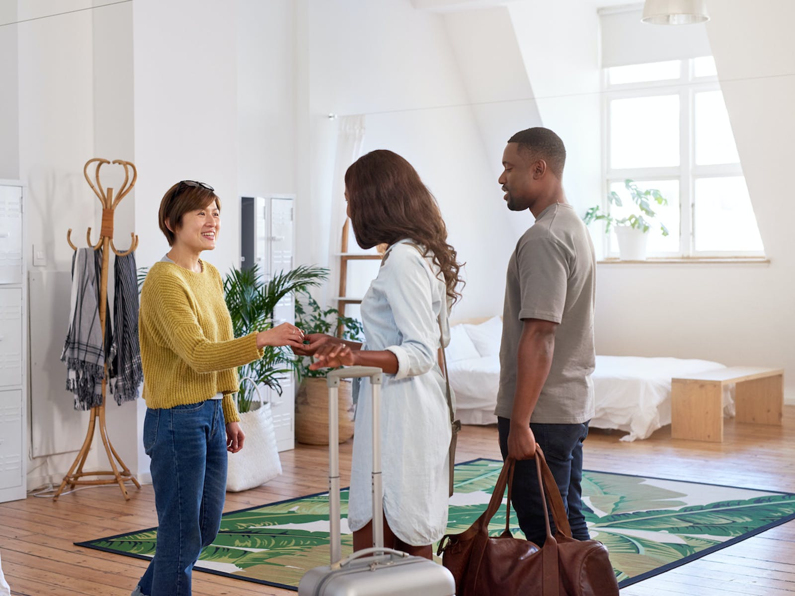 Traveling couple receiving keys to their vacation rental