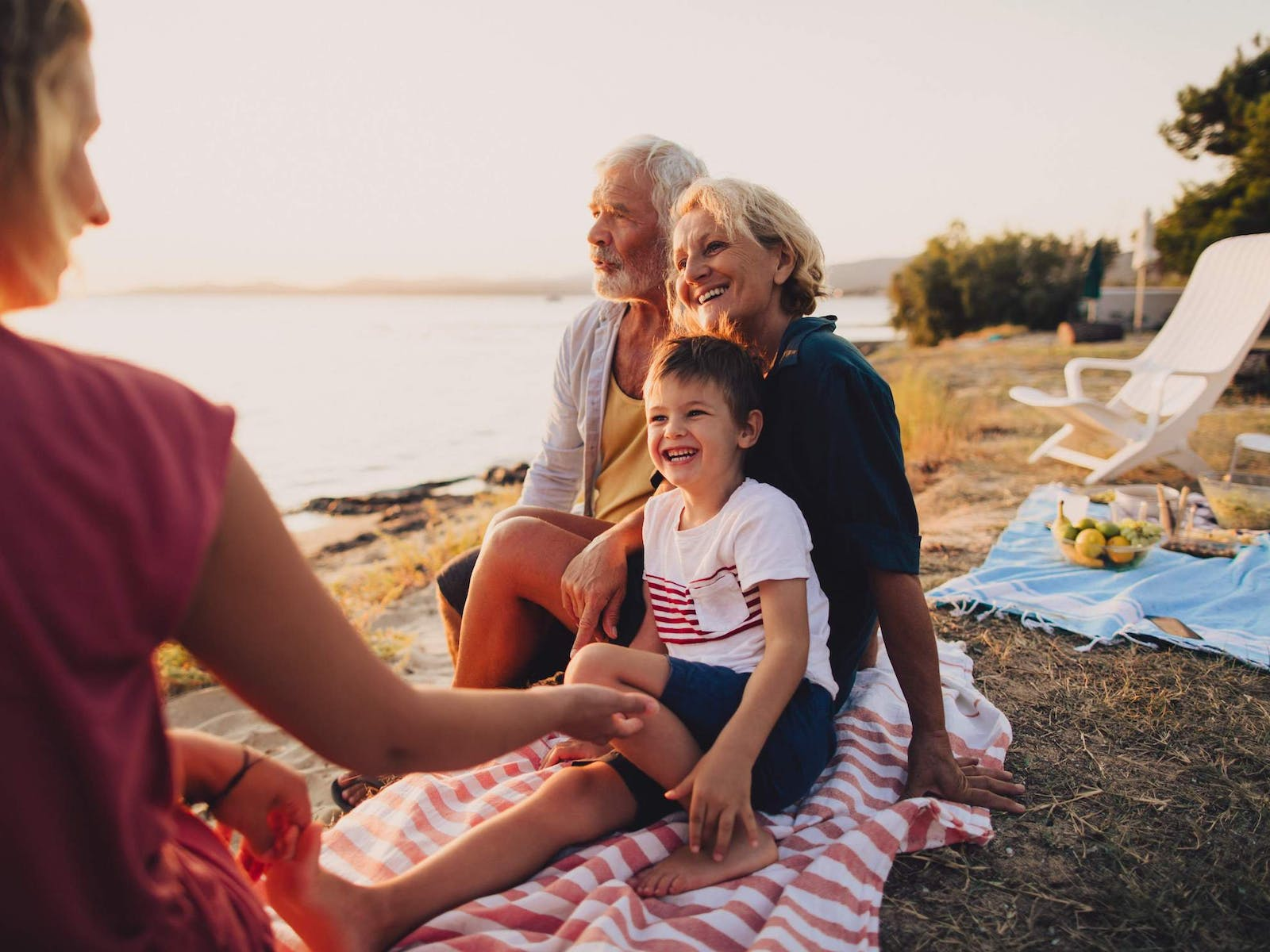 An older couple with their grandchild on the beach
