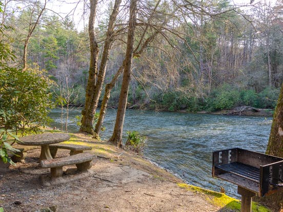 View of Toccoa River with outdoor table and charcoal grill