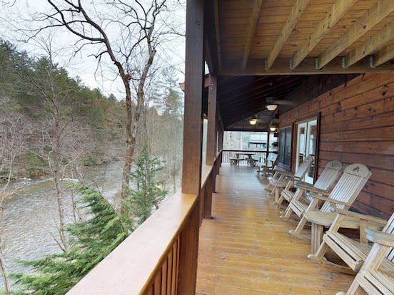 expansive deck of vacation rental overlooks the rushing Toccoa River