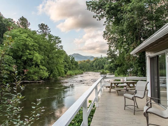 Vacation rental deck overlooking a river in the Blue Ridge Mountains