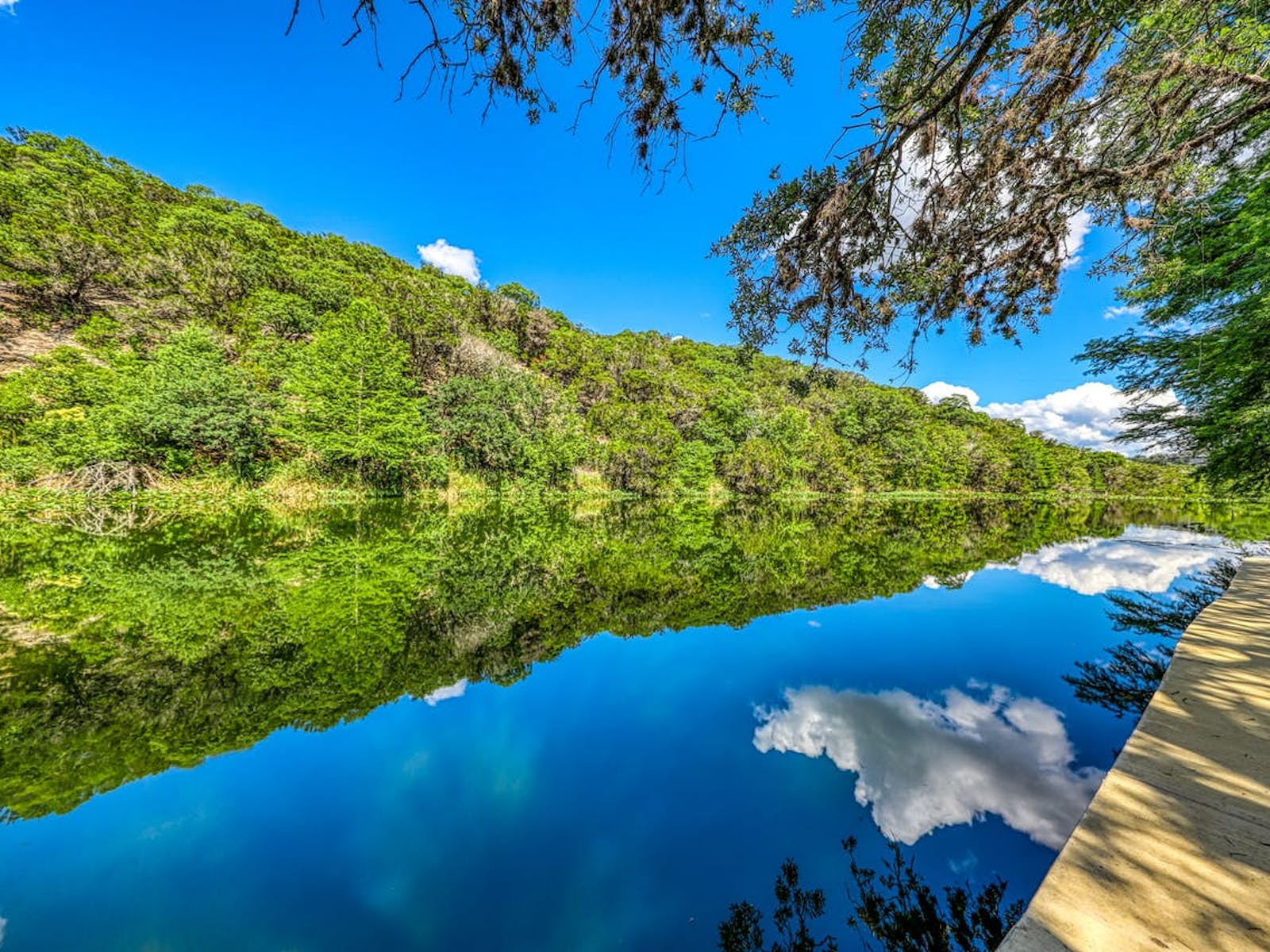 Blue sky and clouds reflected in a river