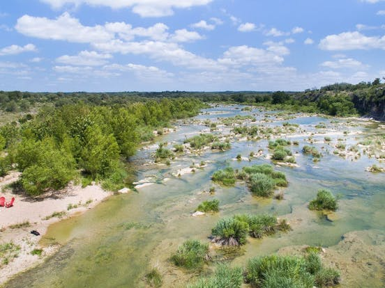 vacation rental sits right next to the Pedernales River in Johnson City, TX