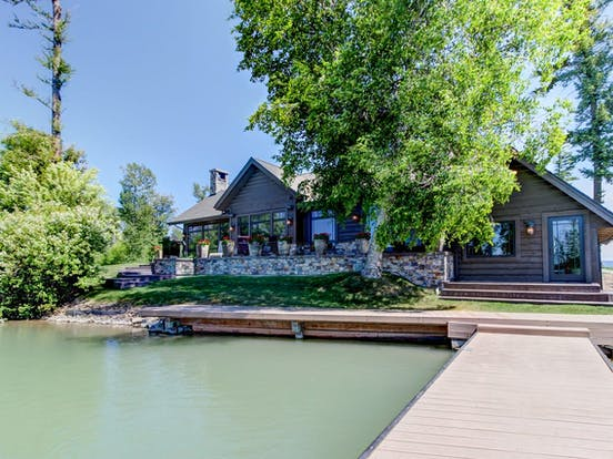 Riverfront vacation home rental with a dock in Montana