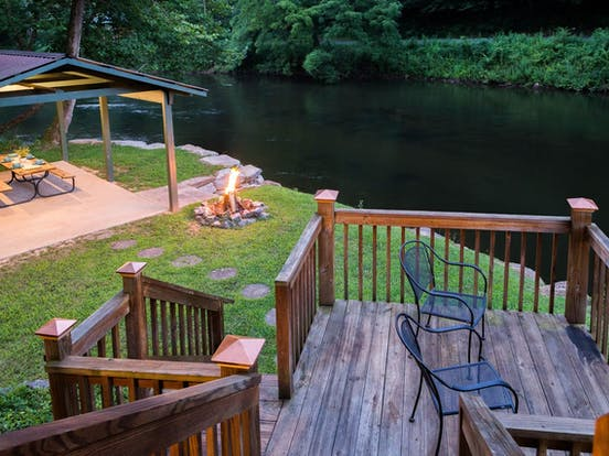 riverfront cabin rental in north carolina with outdoor furniture and firepit