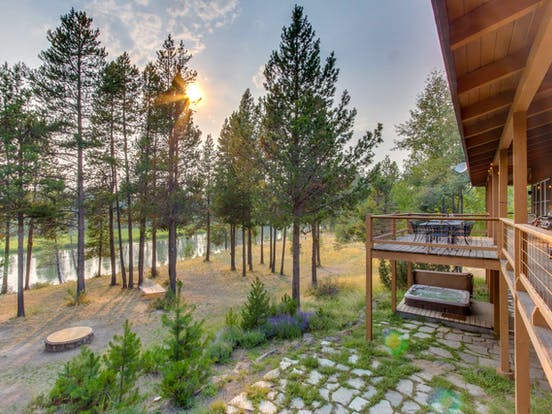Oregon riverfront vacation rental deck surrounded by woods