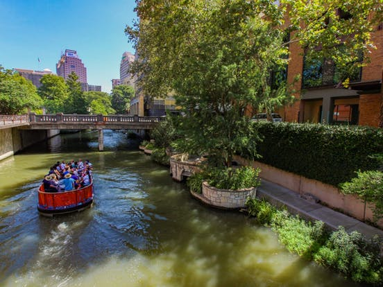 San Antonio River Walk with tourist boat