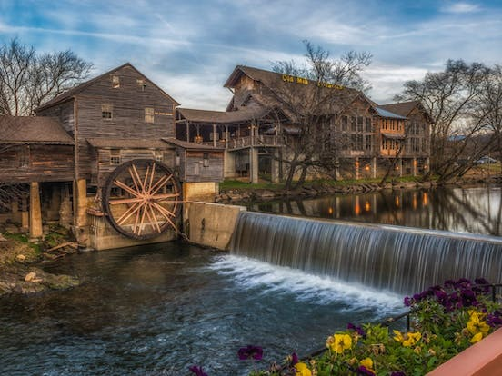 River in Tennessee with wooden building and waterwheel
