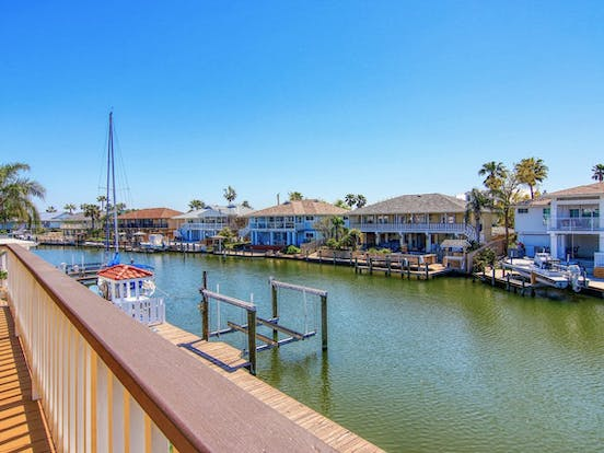 River along the Texas Gulf Coast surrounded by vacation rentals