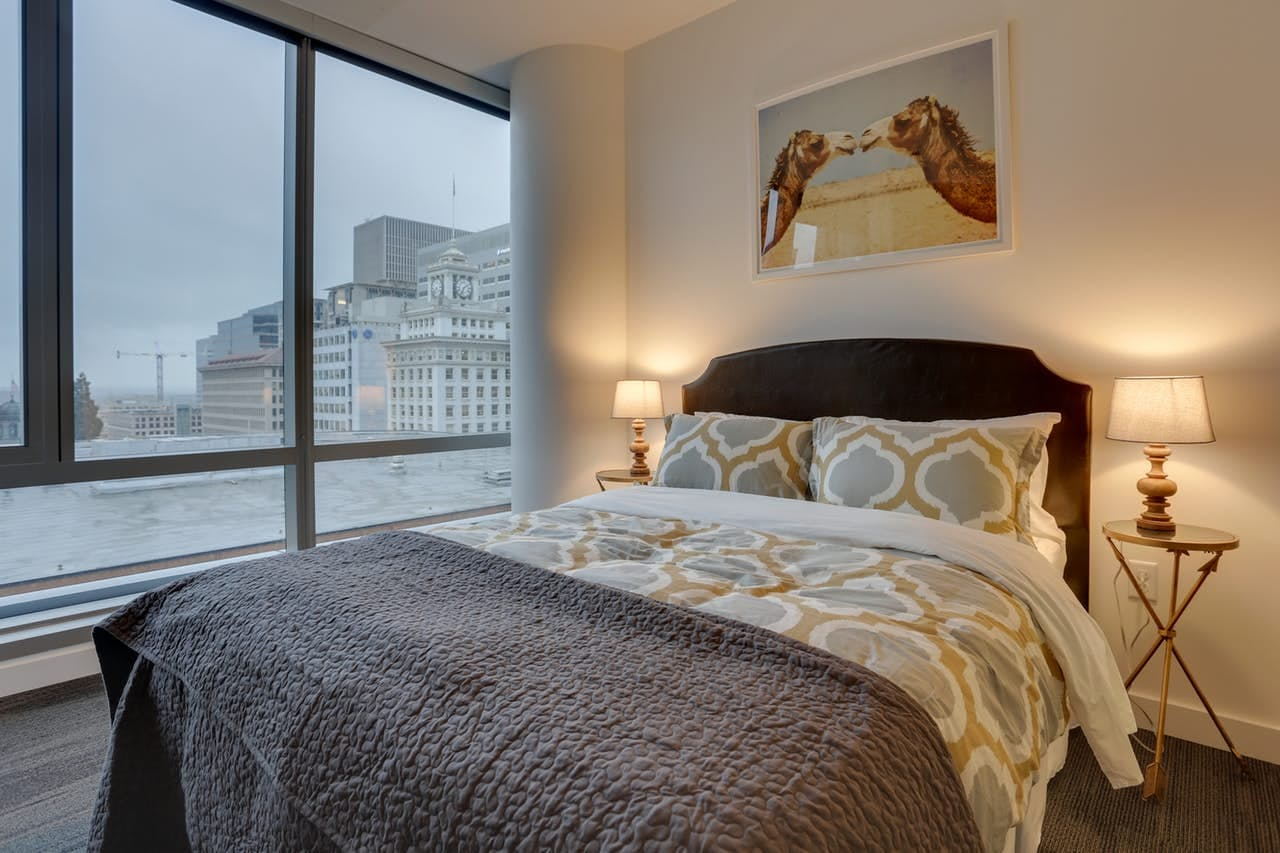the bedroom of Park Avenue West 604, overlooking the city of portland
