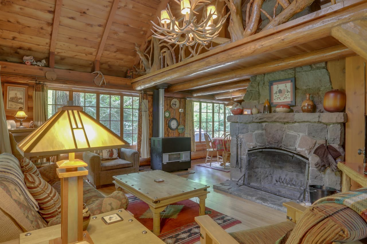 a cozy living room at Zoe's Log Cabin in Brightwood, OR