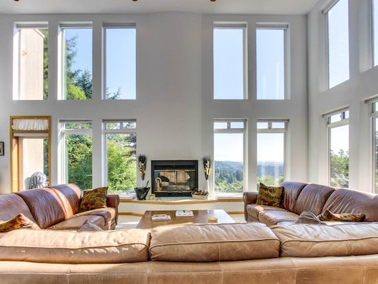 couches in the living room overlooking the forest at Forest Ridge Retreat in Coos Bay, OR
