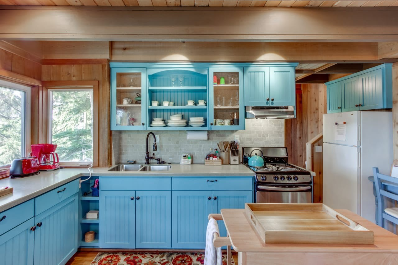a decorated kitchen inside of a cannon beach vacation home