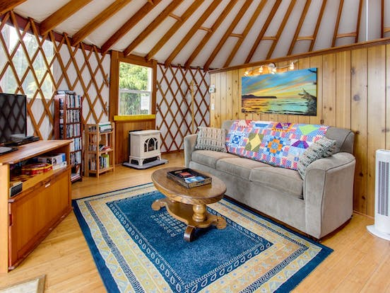 the living room of a yurt located in bay city, oregon