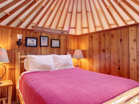 a cozy bedroom inside of a yurt in bay city, oregon