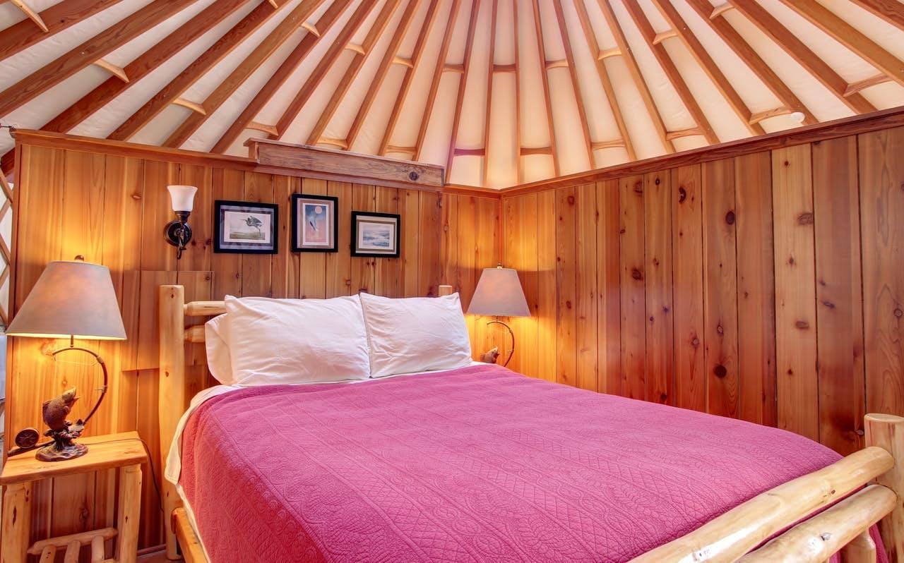 a cozy bedroom inside of a yurt in bay city, oregon