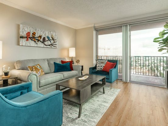Living space of Houston, TX vacation rental with comfy couches, hardwood floors and a balcony