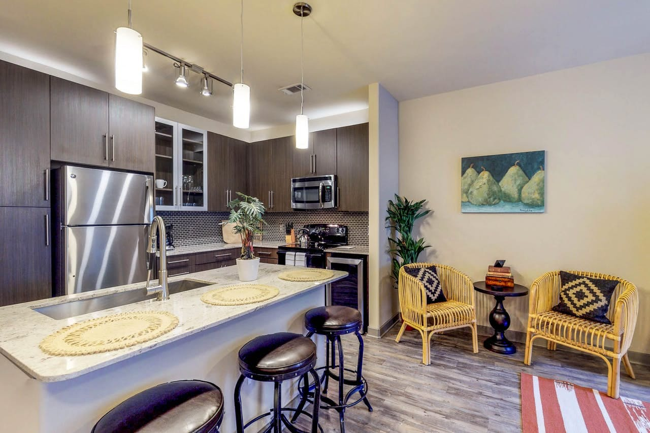 Tastefully decorated kitchen and seating area of Dallas vacation rental