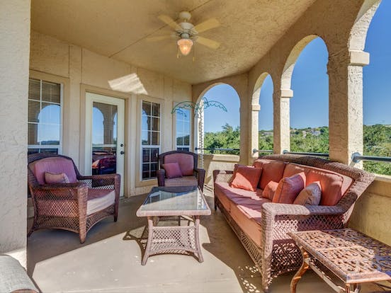 Balcony with arches and columns highlighting views of Lago Vista, TX