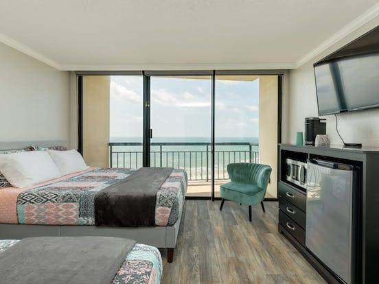 Two beds inside oceanfront condo in Galveston, TX