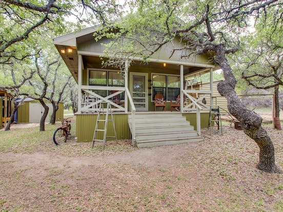 Rustic cabin with walk up front porch in Dripping Springs, TX