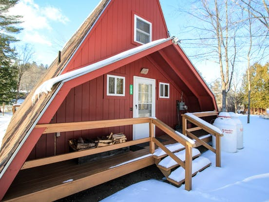 A-frame style cabin in the snow
