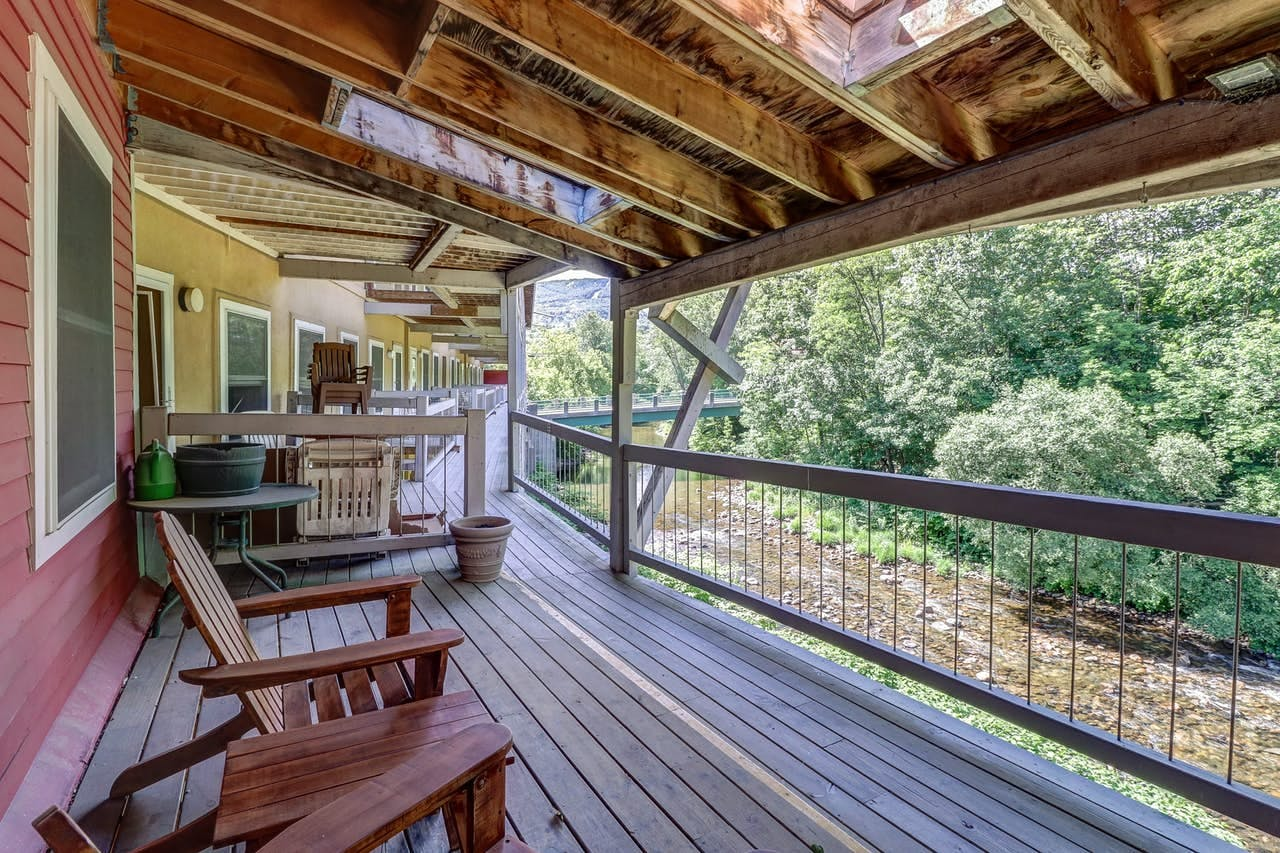 Deck with Adirondack chairs overlooking a river in Vermont