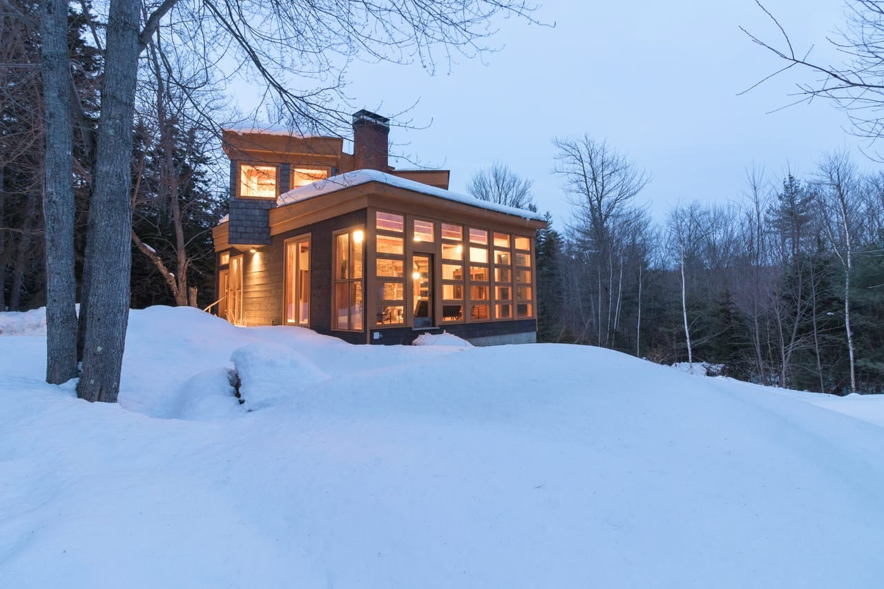 Modern vacation cabin in the snowy woods of Vermont